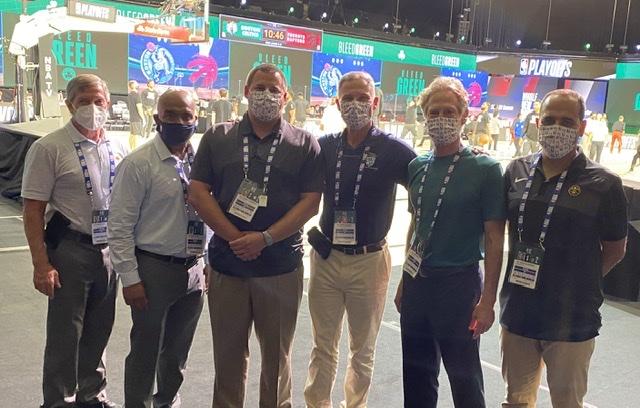 A group of men in masks