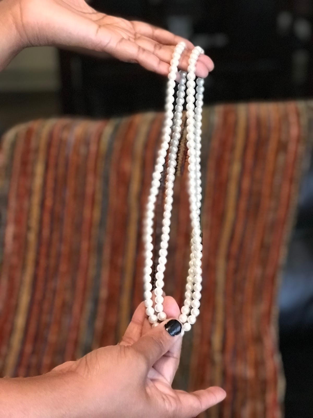 Image: White faux necklace bought by Tangie Bell from a local vintage vendor in the city.