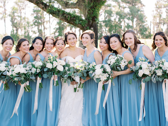 bride with bridesmaids in blue dresses and bouquets