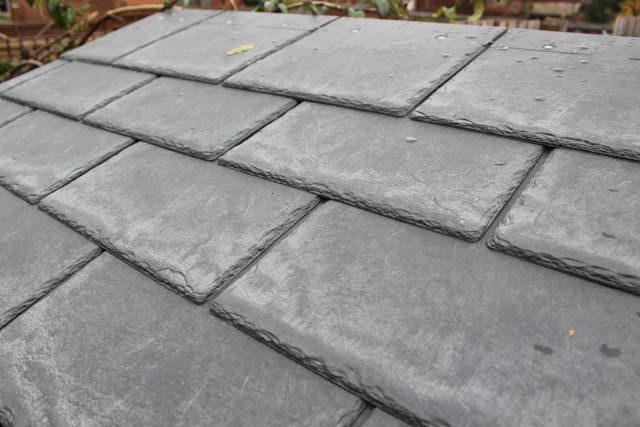 synthetic slate on log store roof