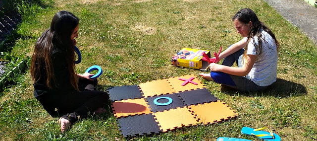 My girls playing giant noughts and crosses in the garden