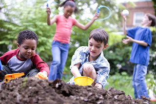 Picture of children playing in dirt