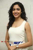 Actress Ritu Varma Stills in White Floral Short Dress at Kesava Movie Success Meet .COM 0003.JPG