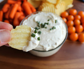 ruffled potato chip freshly dipped in creamy clam dip