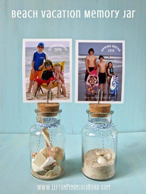Sand and shells in small photo-topped jars.
