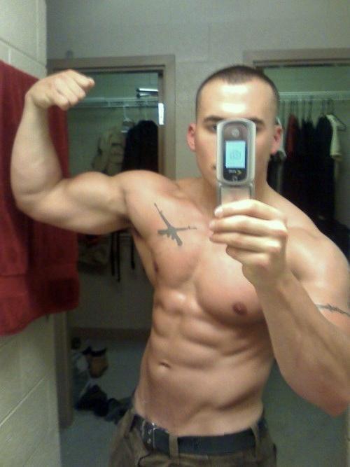 hot-guy-shirtless-fit-body-muscular-abs-biceps-flex-flip-phone-selfie-army-shotgun-chest-tattoo