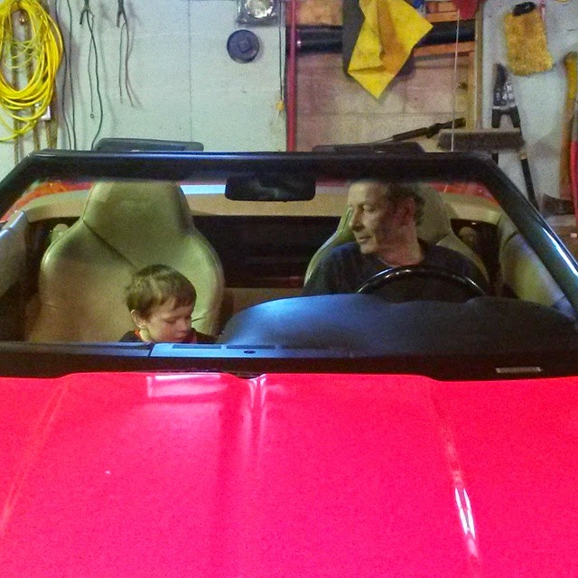 checking out the corvette - copyright Chrystal Scales