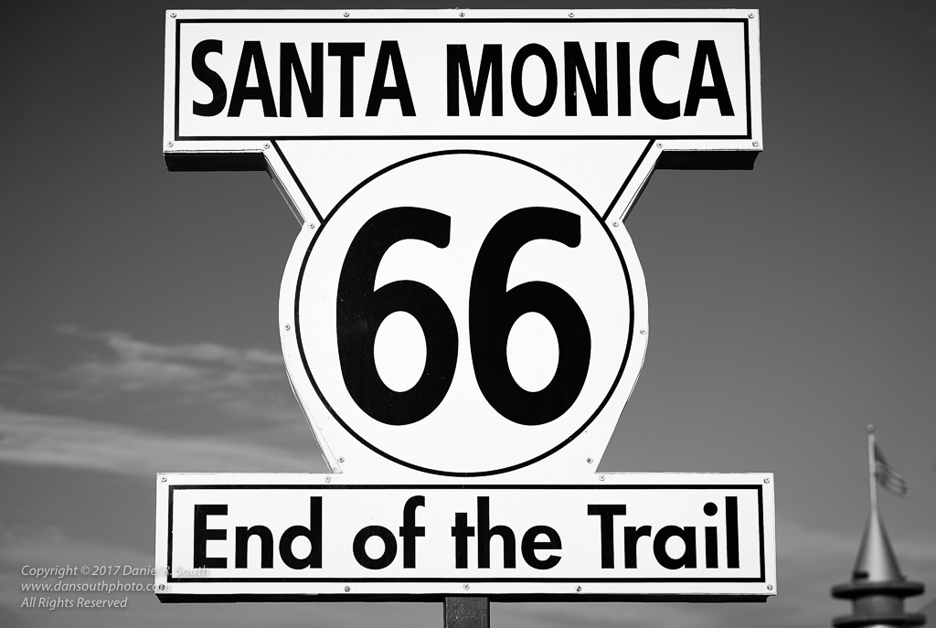 a photo of the route 66 sign on the santa monica pier