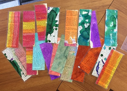 Watercolored bookmarks made from upcycled books