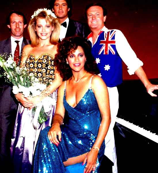 American beauty pageant Pamela Gidley, winner of the Most Beautiful Girl in the World, poses with singers American David Hasselhoff and Australian Peter Allen and Jayne Kennedy at the State Sport Centre in Homebush in Sydney, Australia, March 12, 1985.