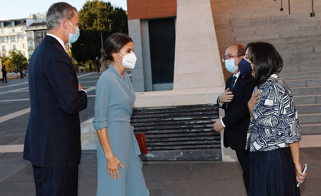 Queen Letizia wore a new wrap around dress by Adolfo Dominguez. Red pumps by Magrit. Earrings by Tous jewelry