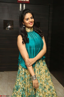Anchor Srimukhi in green sleeveless top and skirt at O Pilla Nee Valla Movie Audio Launch Feb 2017 015.JPG