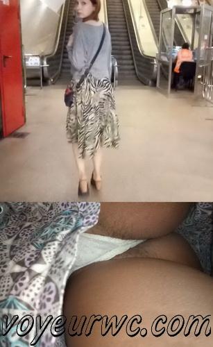 Upskirts 3907-3926 (Secretly taking an upskirt video of beautiful women on escalator)