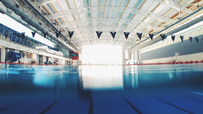 Image of a commertial indoor swimming pool. Keeping Clients Swimming Through Winter