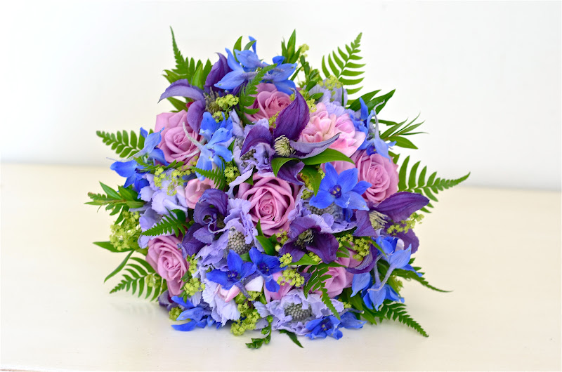 Country Style Wedding Bouquet In Bright Blue Purple Dusky Pinks And Lime Using Delphinium Rose Clematis Freesia Alchemilla Mollis Sword Fern