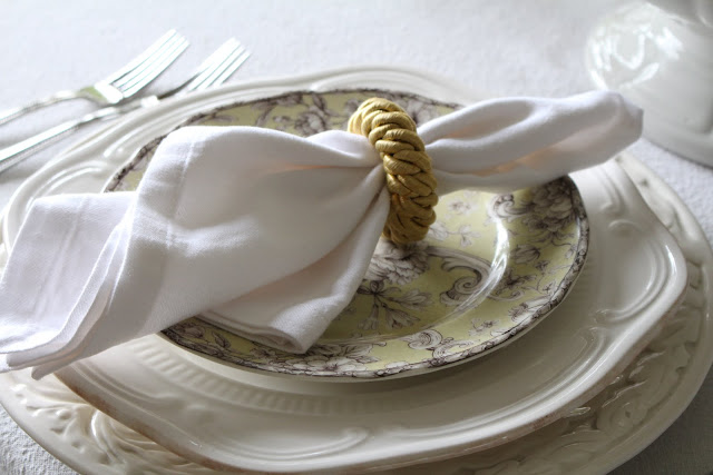 spring floral tablescape place setting green toile plate white napkin yellow rope napkin ring
