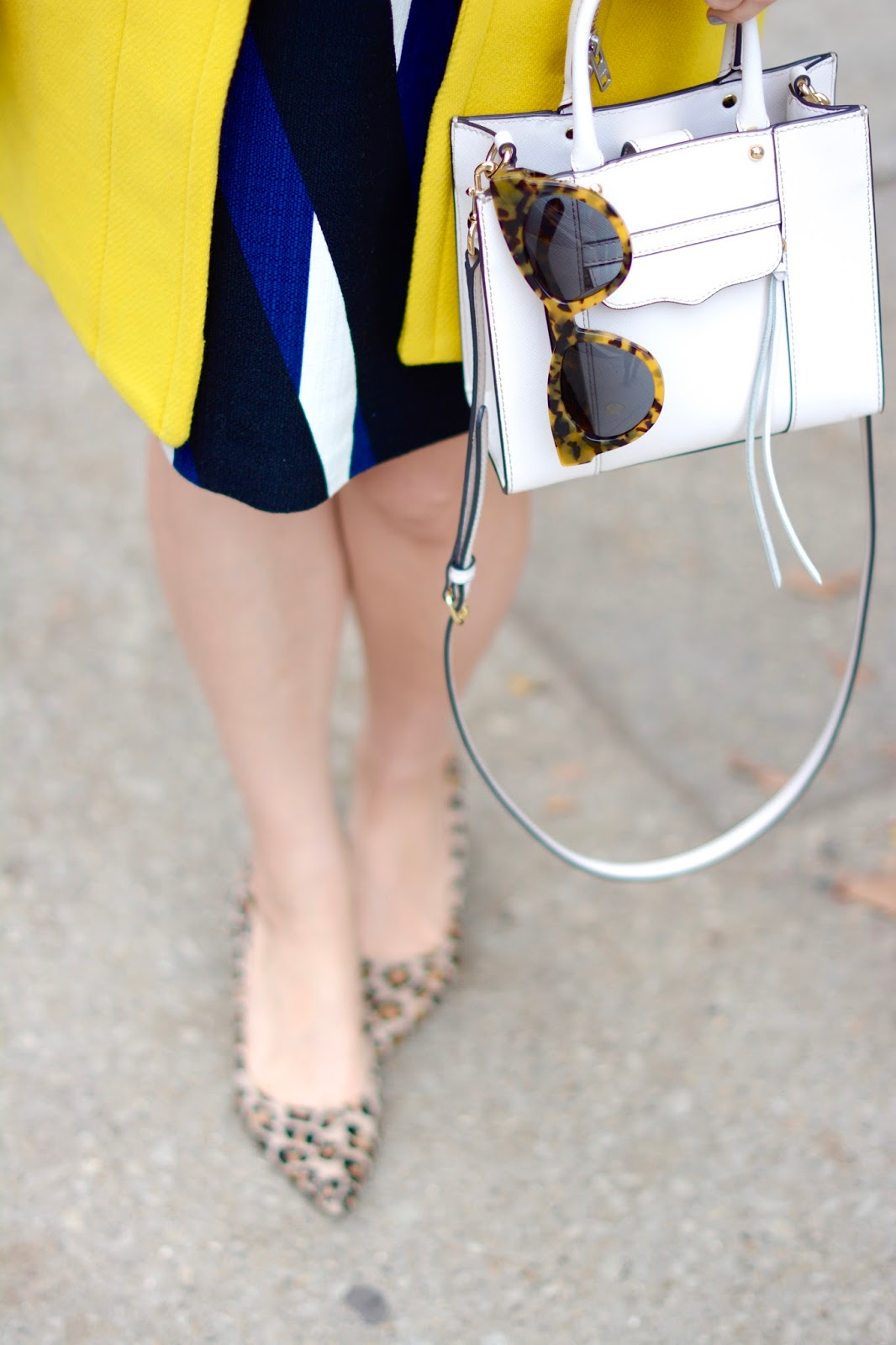 yellow j crew cocoon coat, trina turk dress, white Rebecca Minkoff Mini mab tote white, starburst karen walker sunglasses