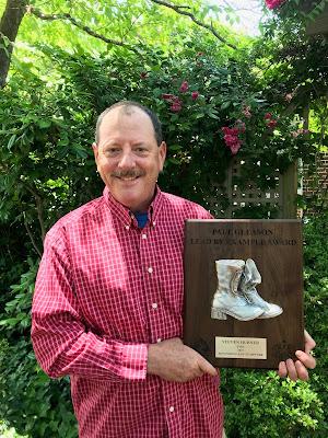 Steven Hubner with award