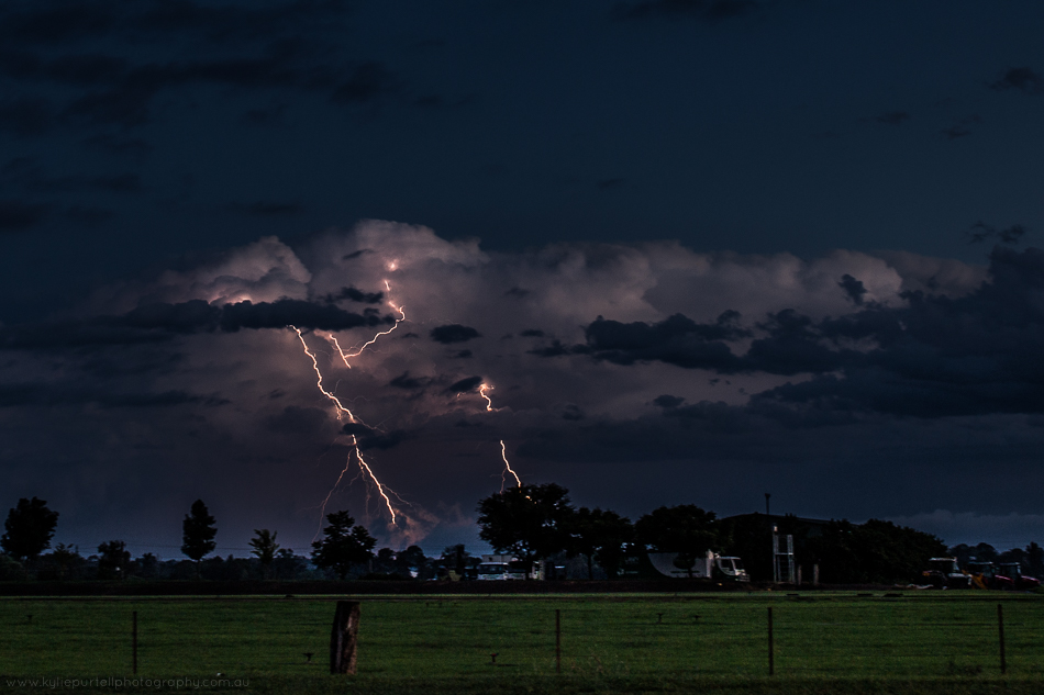 lightning in storm clouds over farmland, hawkesbury nsw