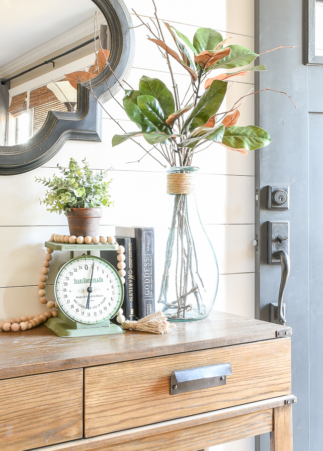 Modern farmhouse entryway with aged Terra Cotta Pots