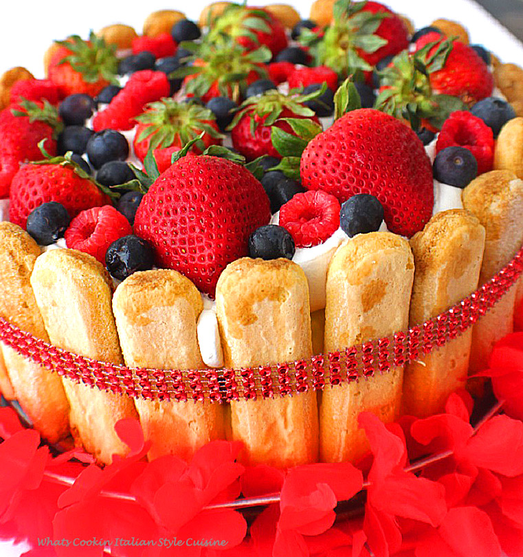 lady finger lemon dessert with red white and blue fruits