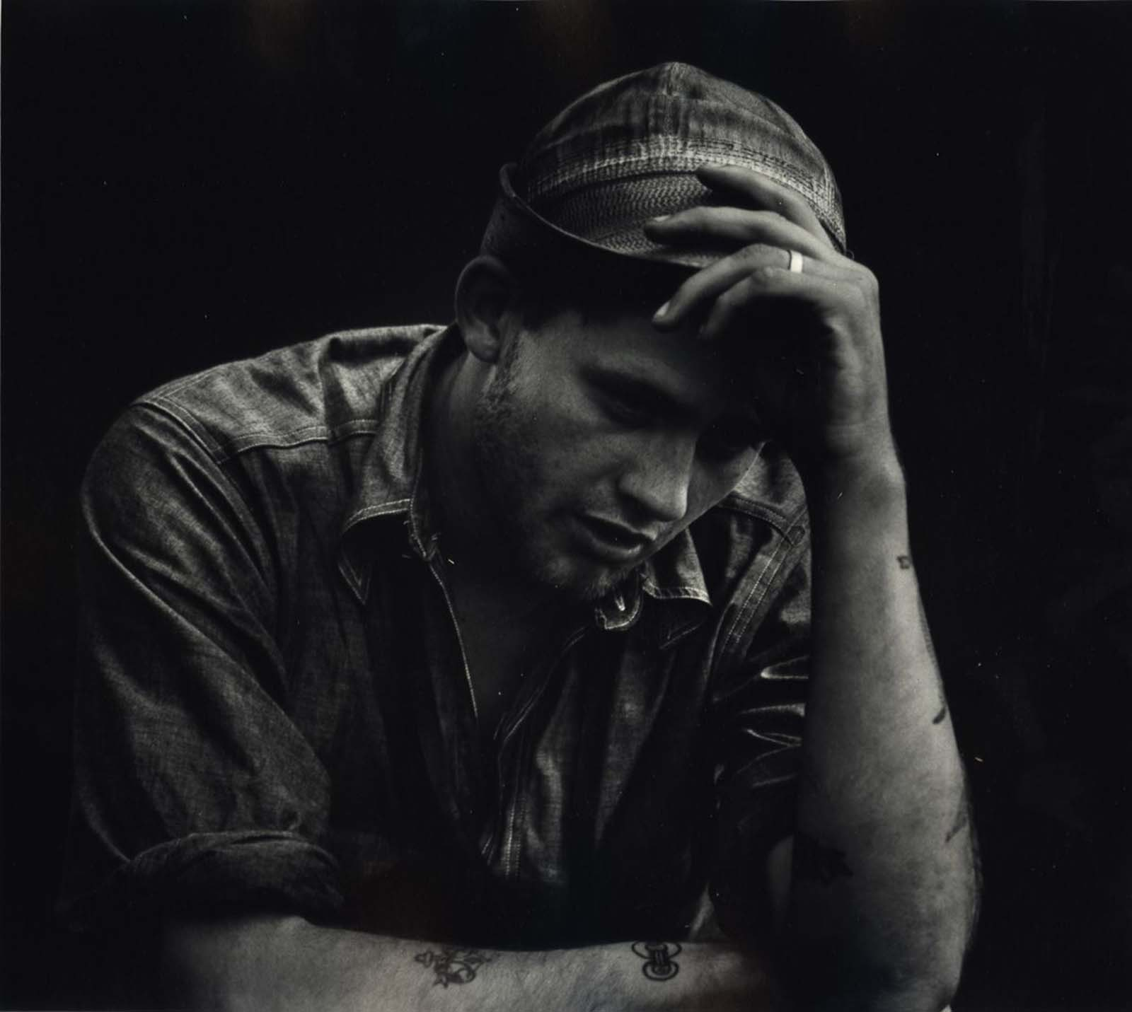 A man holding his hat, c. 1942-1945.