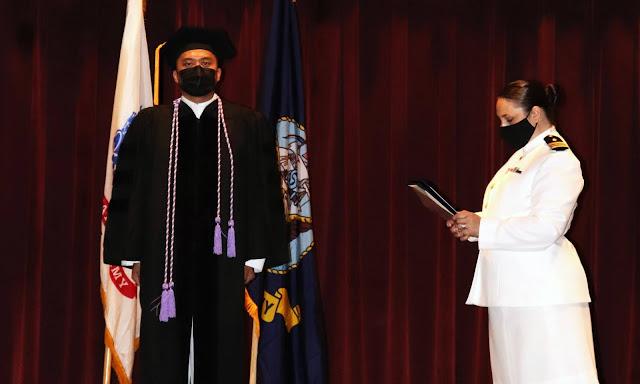 Christopher Bunag at a graduation ceremony.