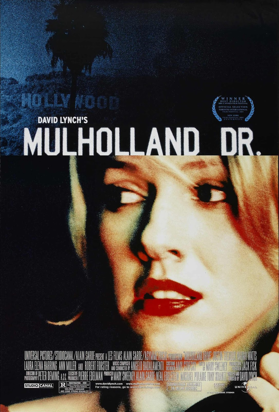 The theatrical release poster for Mulholland Drive. It is divided into two panels. The top panel shows a darkened photograph of the Hollywood Sign obscured by a palm tree. The bottom panel depicts Laura Harring looking nervously to her right.