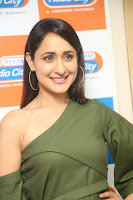 Pragya Jaiswal in a single Sleeves Off Shoulder Green Top Black Leggings promoting JJN Movie at Radio City 10.08.2017 149.JPG