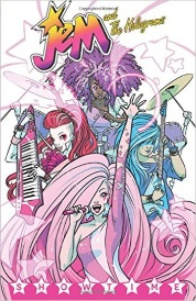 Cover of Jem and the Holograms Volume One, Showtime, featuring four girls with diverse skin tones, hair colours, and body types performing on stage.
