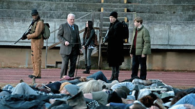 Movie still for 2016 horror film Cell where John Cusack, Samuel L. Jackson, and stumble upon Stacy Keach and a pile of dead bodies