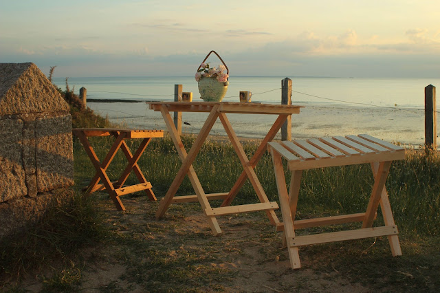 Pallet wood furniture for and evening at the beach