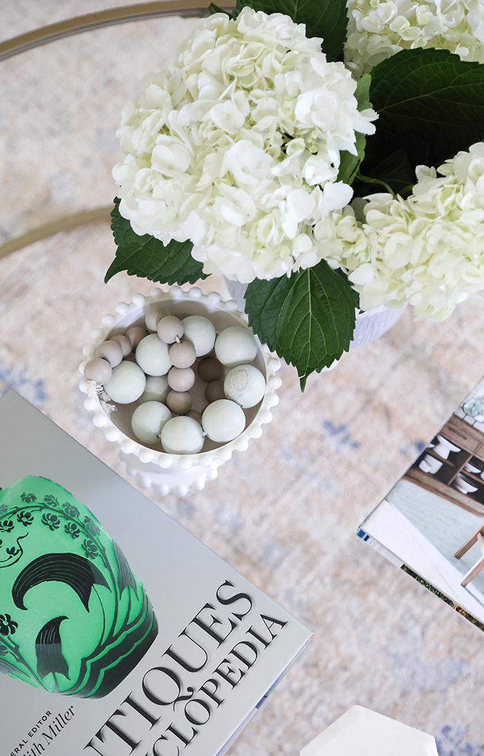 hydrangea and wooden beads on glass coffee table