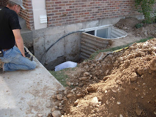 The workers working on the water line and foundation