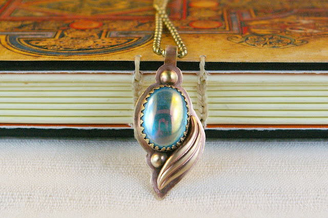 https://www.etsy.com/ca/listing/672352464/antique-aqua-aura-ab-glass-brushed-brass