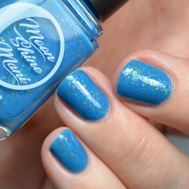 blue nail polish with flakies