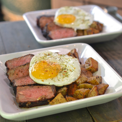 NY Strip Steak, Over Easy Potatoes and Eggs featuring Girl Carnivore's Over Easy Seasoning