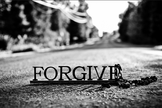forgive sign in road with chain