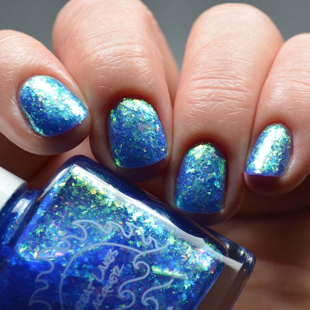 blue flakie nail polish low light swatch