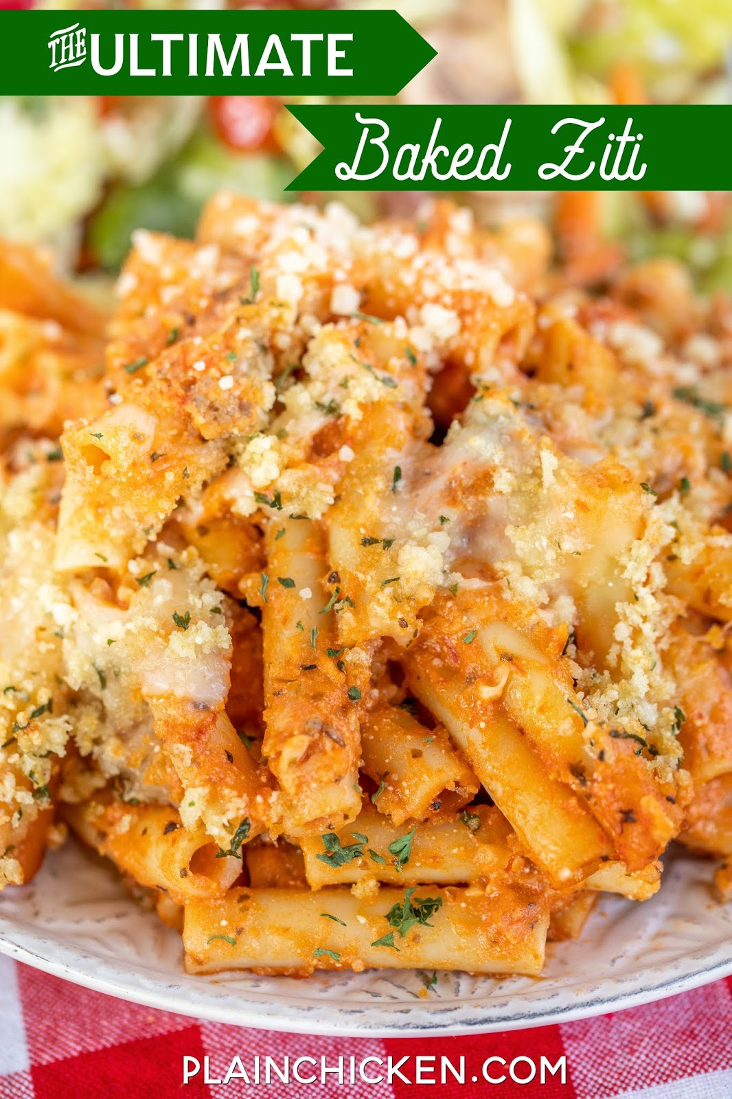 baked ziti and salad on a plate