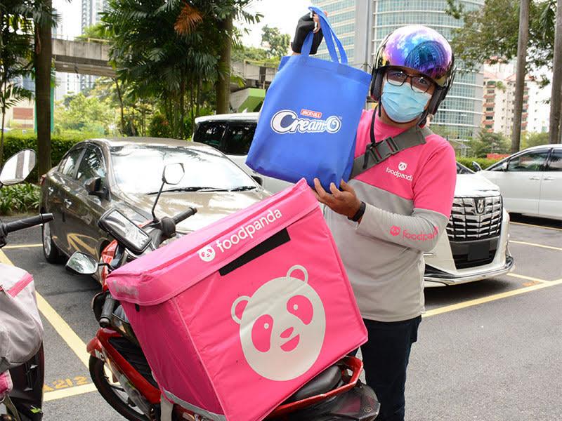 A foodpanda rider with his Cream-O 'Ekstra-O-some' thank you kit