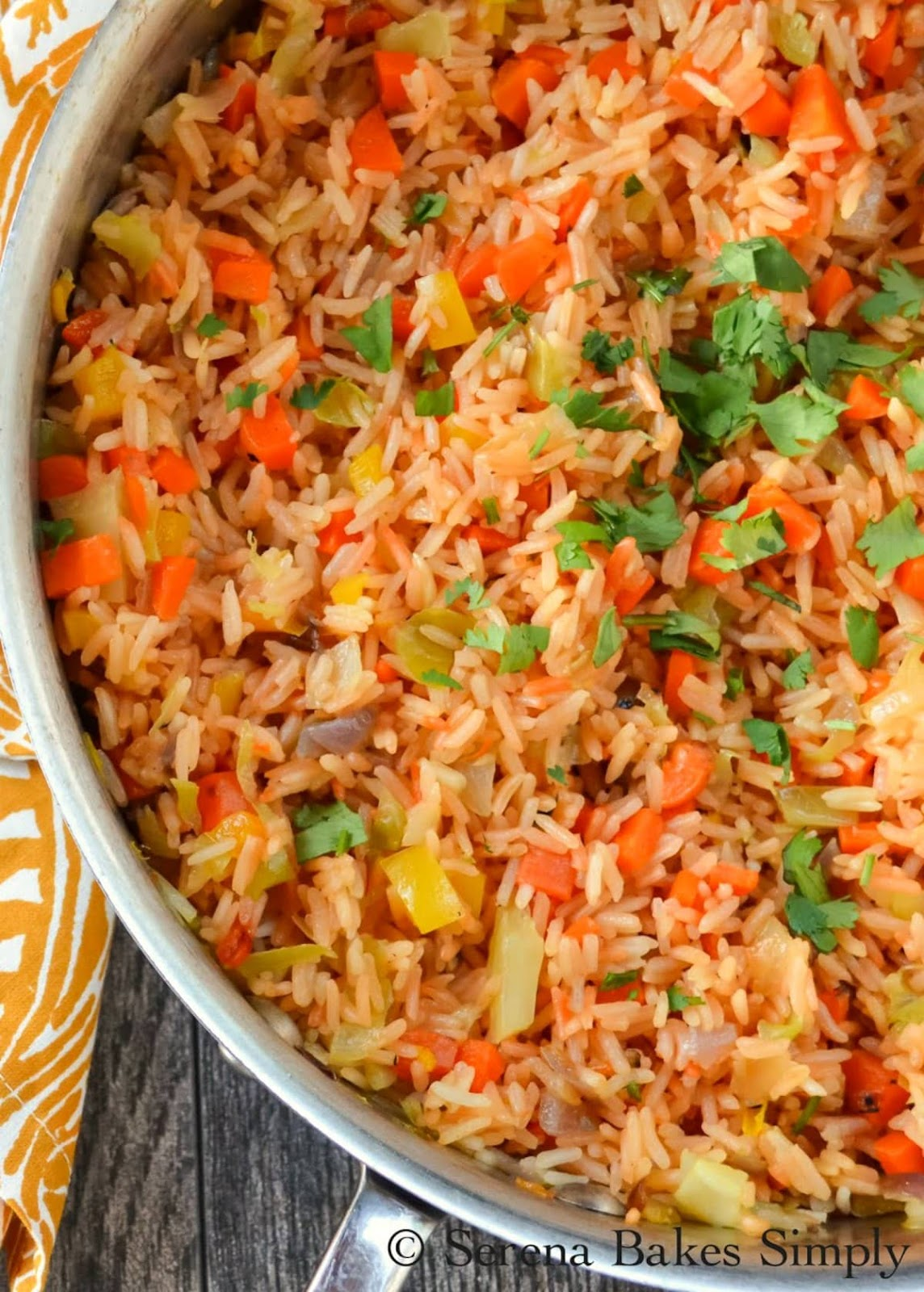 Authentic Restaurant Style Mexican Rice recipe is an easy family favorite! A must for your next Mexican food night from Serena Bakes Simply From Scratch.