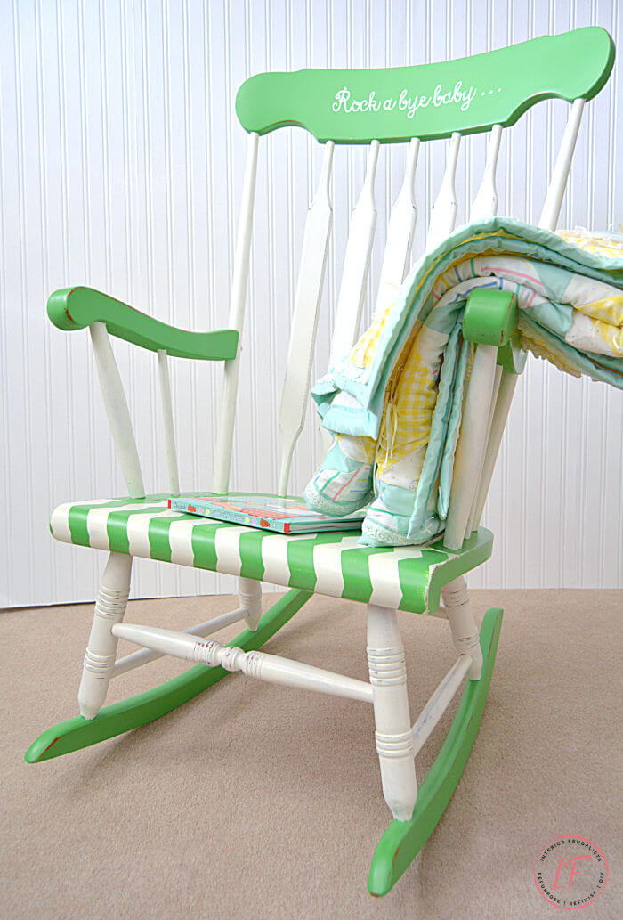 A vintage wooden rocking chair makeover in white and green for a baby nursery with fun chevron stripes and sweet hand painted typography.
