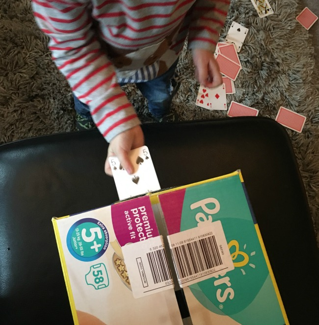 5-minute-games-for-toddlers-posting-cards-toddler-posting-card-through-hole-in-box
