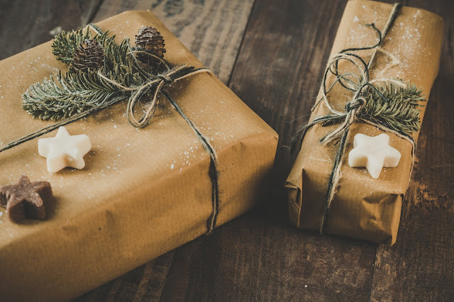 Christmas gifts wrapped in brown wrapping paper.