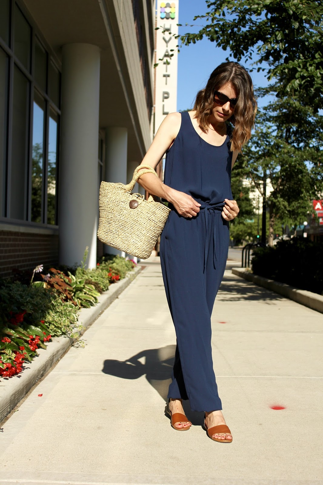 Straw Tote and Navy Jumpsuit