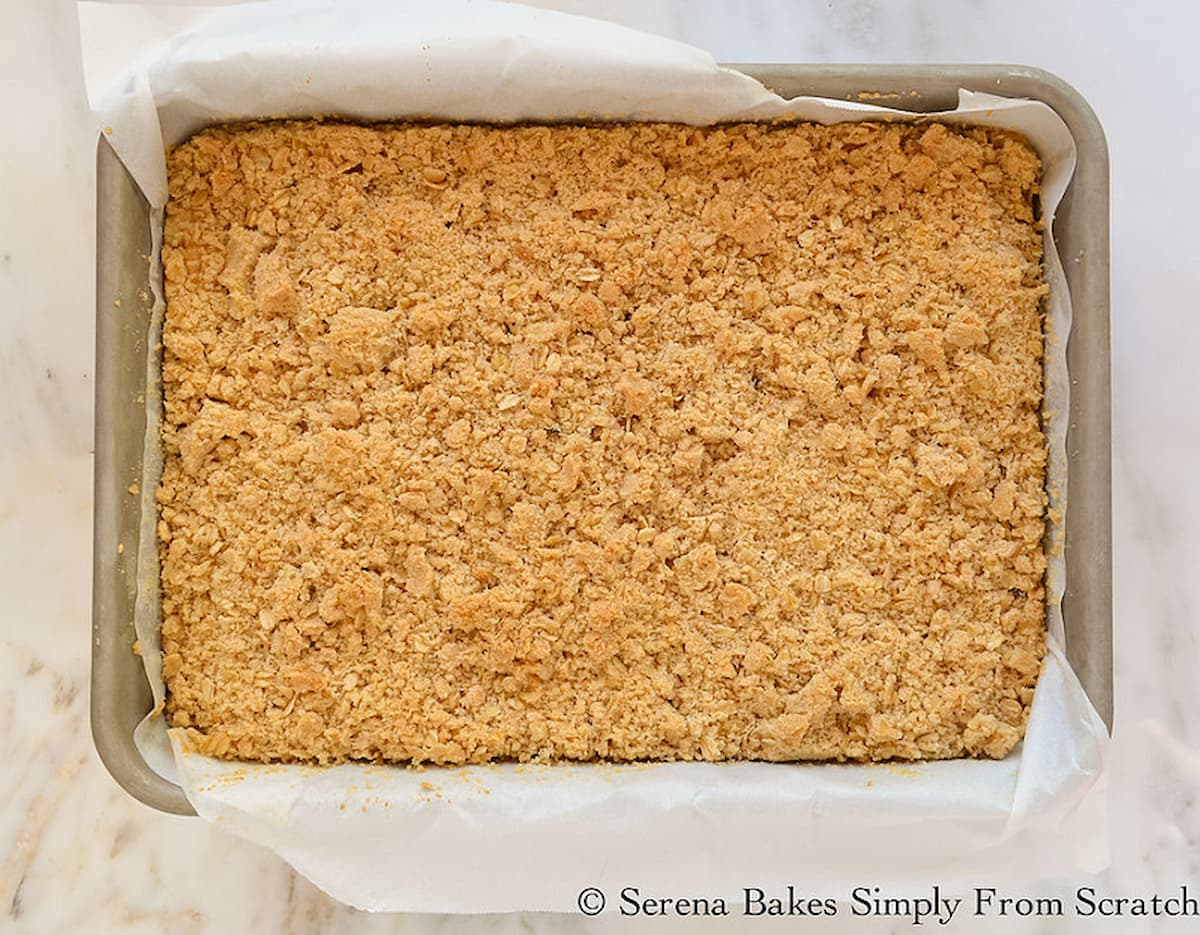 "Baked Lemon Cheesecake Crumb Bars in a 9""x13"" pan."
