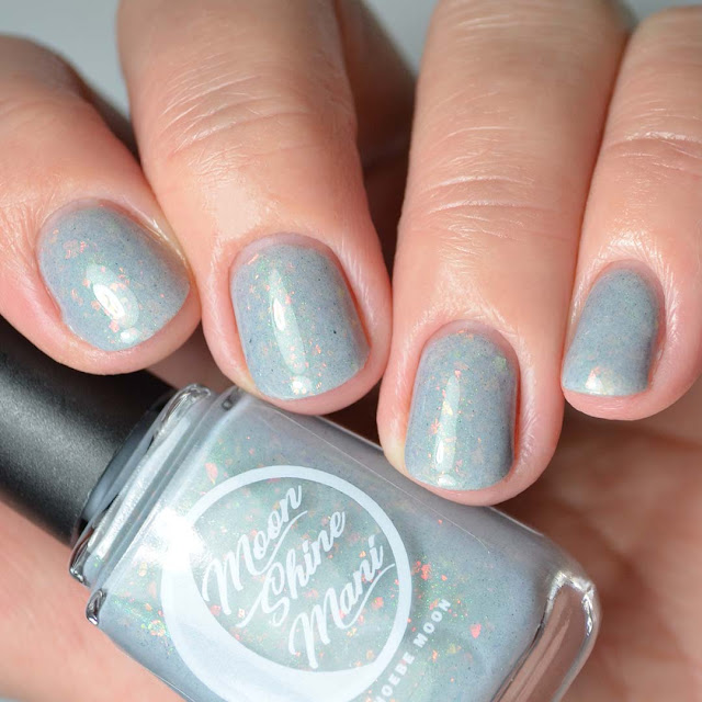grey nail polish with flakies four finger swatch