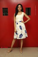 Actress Ritu Varma Stills in White Floral Short Dress at Kesava Movie Success Meet .COM 0147.JPG