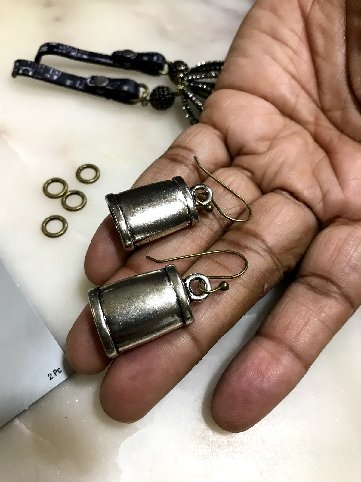 Image: end caps and jewelry pieces used to make earrings for quick earrings
